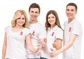 picture of hiv  - Group of young positive people with red ribbon supporting AIDS HIV prevention - JPG