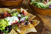 picture of nachos  - Homemade Nachos with tortilla chips cheese and guacamole - JPG