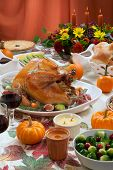 picture of kumquat  - Roasted turkey on a server tray garnished with fresh figs grape kumquat and herbs on fall harvest table - JPG