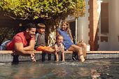 Постер, плакат: Happy Family Having Fun By The Swimming Pool