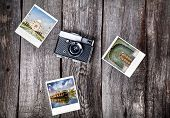 picture of polaroid  - Old film camera and polaroid photos with Indian famous landmarks on the wooden background - JPG