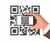 foto of qr codes  - Businessmans hand holding smartphone with QR - JPG