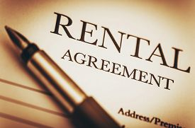 picture of rental agreement  - Rental Agreement and Fountain Pen. Ready to Sign Rental Contract. Residential Real Estate Concept Photo.