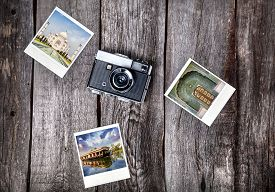 image of polaroid  - Old film camera and polaroid photos with Indian famous landmarks on the wooden background - JPG