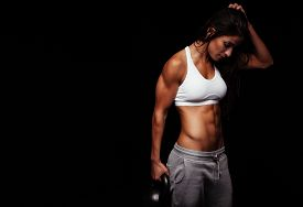 foto of athletic woman  - Fitness woman exercising crossfit holding kettle bell - JPG