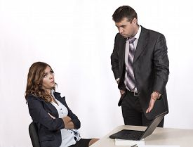 picture of inappropriate  - Female office employee caught by manager at inappropriate social networking during working hours Boss is criticising her pointing the laptop - JPG