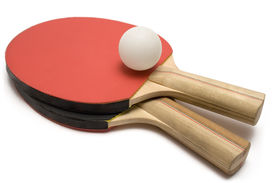 stock photo of ping pong  - two ping pong paddles with ball isolated on white - JPG
