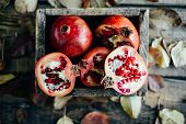 Ripe Pomegranate Fruit On Wooden Vintage Background. Red Juice P poster