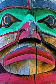 image of indian totem pole  - Face carved on a Canadian Indian totem pole. Native Indian colorful woodcarving typical of the north west coast of British Columbia Canada. Used in religious rituals as well as in festivities surrounding native Indian folklore. 
