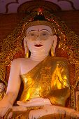 stock photo of omnipresent  - the giant bespectacled buddha statue in burma - JPG
