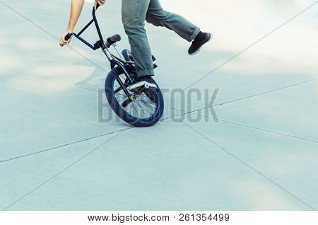Bycicle Rider Performing A Trick