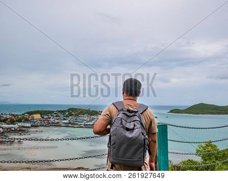 poster of Asisn Fat Backpacker Stand On Top Of  Khao Ma Jor Pier  With Idyllic Ocean Beautiful White Cloud End