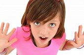 picture of ten years old  - Beautiful 10 year old girl with hands out and surprised expression over white - JPG