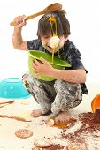 foto of yoke  - Adorable 7 year old boy making mess baking cookies - JPG