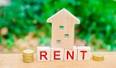 Wooden House, Coins With The Inscription Rent. Rental Of Property, Apartments. Services Of A Realtor poster