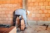 Bricklayer Worker Installing Brick Masonry On Interior Wall With Trowel Putty Knife poster