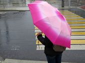 Woman With Pink Umbrella Standing Near The Pedestrian Crossing. Rainy Weather In The City, Heavy Rai poster