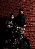 Biker Couple. Biker Couple In Leather Jacket. Sexy Biker Couple With Motorcycle. Biker Couple Travel poster