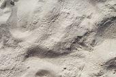 White Sand Beach Texture. Sea Coast Top View Photo. Marine Texture. Smooth Sand Surface With Sea Wav poster
