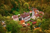 Scenic Landscape View Of Picturesque Rural Village Houses In The Mountain Forest Valley In Autumn At poster