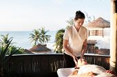 Massage therapist massaging at a spa poster