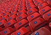 Empty Rows Of Red Concert Seats. Abstract View Of An Empty Concert Row. Rows Of Red Seats. Red Chair poster