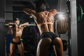 Attractive Sporty Woman Relaxing With Barbell In Gym. Beautiful Fitness Girl Resting After Sport Wor poster