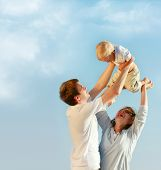 stock photo of family vacations  - happy family on sky background - JPG