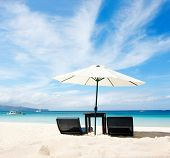chairs and umbrella on tropical beach