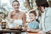 Happy Family Of Hippies Eating Tasty Food poster
