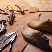Leather Craft Tools On Wooden Background. Workplace For Shoemaker. Piece Of Leather. Cobbler Workpla poster