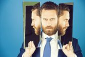 Business Man With Beard, Wearing Suit, Tie, Holding Mirror With Face Reflection, Concept Of Self Ass poster