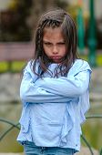 Angry Little Girl Showing Frustration And Disagreement poster
