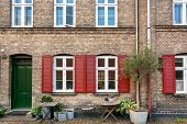 Lounge Area Near Historical Brick House In Traditional Style In Copenhagen, Denmark. Facade Of Old B poster