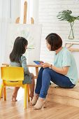 Little Girl Painting On Canvas With Private Teacher poster