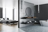 Interior Of Master Bedroom With A Bathroom Next To It. Gray Walls, Concrete And Wooden Floor. Luxury poster