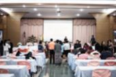 Behind Groub Audience Listening Speaker Speech In Conference Hall Or Seminar Room With Blur Light Pe poster