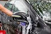 Cleaning Automobile Using High Pressure Water. Man Washing His Car Under High Pressure Water In Serv poster