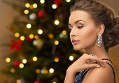 people, luxury, jewelry and fashion concept - close up of beautiful woman in black wearing diamond e poster