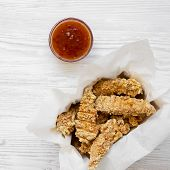 Chicken Tenders In Paper Box With Sauce On A White Wooden Background, Overhead View. Flat Lay, Top V poster