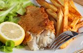 stock photo of rocket salad  - A dinner of fish and chips  - JPG