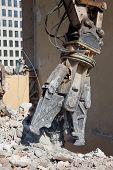 picture of crusher  - Jaw of hydraulic crusher tearing down the building