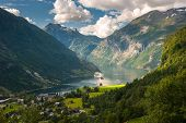 stock photo of passenger ship  - Panoramic view of beautiful Geiranger fjord Norway - JPG