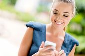 picture of sms  - Portrait of a happy business woman texting on her phone - JPG