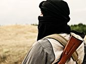 picture of rebel  - Muslim rebel with automatic rifle and machine - JPG