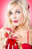 picture of strawberry blonde  - Stunning blond female drinking strawberry nightclub cocktail through heart shape straw - JPG