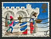 UK - CIRCA 1973: A stamp printed in UK shows image of the Good King Wenceslas, the Page and Peasant,