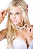stock photo of chokers  - Portrait of attractive young blond woman with silver necklace or choker white background - JPG