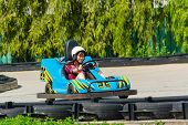 stock photo of karts  - Cute Thai girl is driving Go - JPG