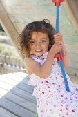 happy smiling child playing on swing